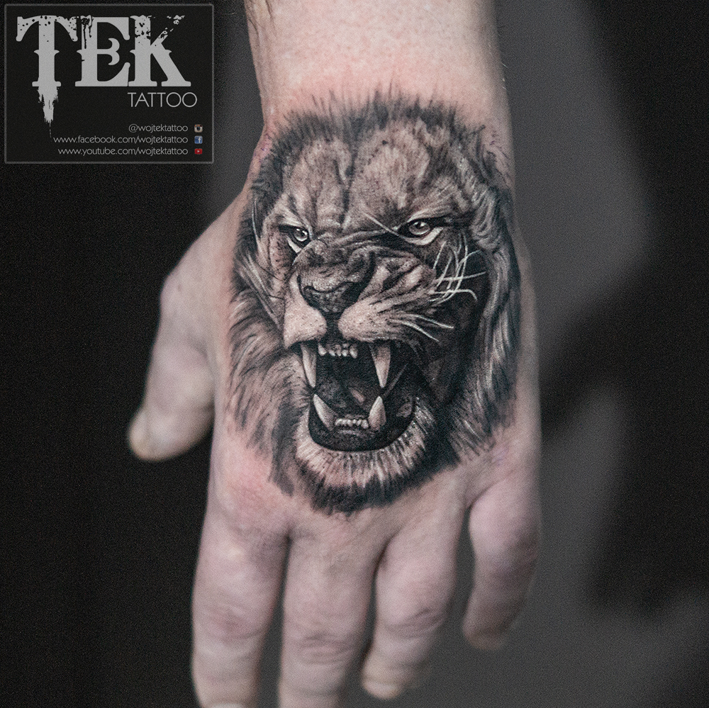 af3bbb37d386a Black and grey lion hand tattoo