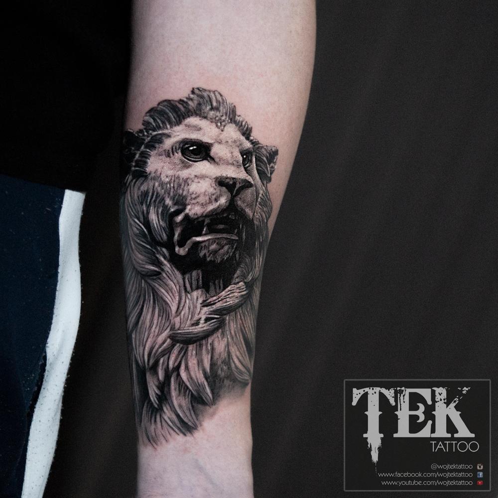 Greek lion sculpture tattoo